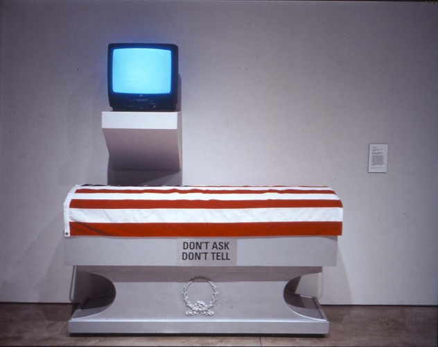 Mel Roman, Coming Out Under Fire, 1998. Casket, flag, vinyl and single-channel color video with monitor, 80 x 74 x 31 inches. Collection of the Scottsdale Museum of Contemporary Art. Gift of the artist and the Arizona Human Rights Fund