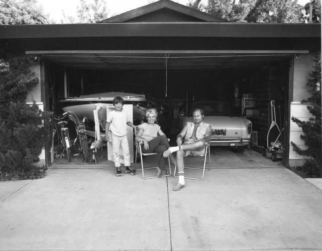 "Bill Owens, Our house is built with the living room in the back, so in the evening we sit out front of the garage and watch the traffic go by. From the series ""Suburbia"", 1973. Gelatin-silver print, 7 x 9 inches. Image courtesy of the artist and Robert Koch Gallery. © Bill Owens"