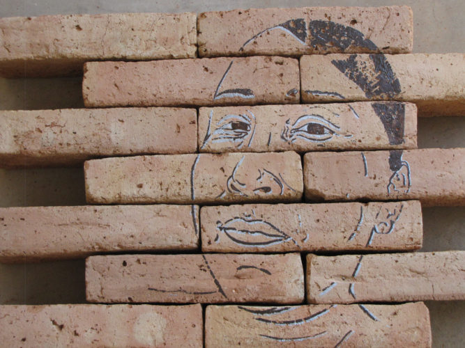 Gabriela Muñoz and M. Jenea Sanchez, Labor (detail), 2016. Serigraph on bricks made with Mexican soil. 36 x 264 x 6 inches. Courtesy of the artists. © Gabriela Muñoz and M. Jenea Sanchez