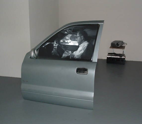 Peter Sarkisian, Registered Driver, 2004. Mixed media, video projection. 30 x 36 x 9 inches. Courtesy of I-20 Gallery, New York. © Peter Sarkisian