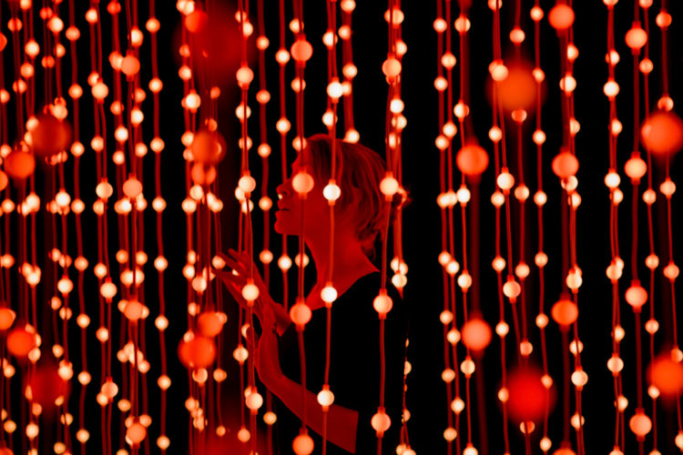Red hanging lights with a women