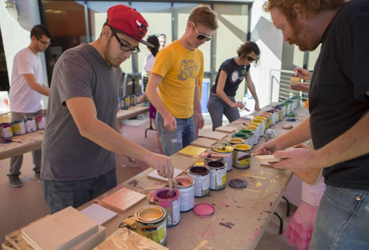 Community members helped create a mural with James Marshall (a.k.a. Dalek). Photo: Chris Loomis